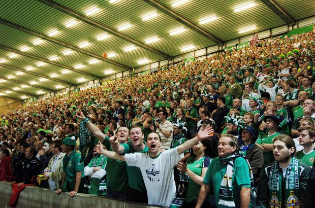 Packed house: Irish FA chiefs must work out how to re-house thousands of fans for Northern Ireland's clash with Romania if, as is expected, the Kop Stand at Windsor Park is condemned
