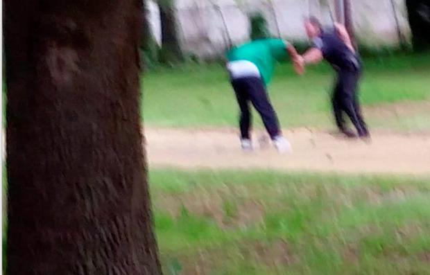 Walter Scott appears to be struggling with Michael Slager (AP Photo/Courtesy of L. Chris Stewart)