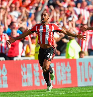 SUNDERLAND, ENGLAND - APRIL 05: Jermain Defoe of Sunderland celebrates scoring the opening goal during the Barclays Premier League match between Sunderland and Newcastle United at Stadium of Light on April 5, 2015 in Sunderland, England. (Photo by Michael Regan/Getty Images) *** BESTPIX ***