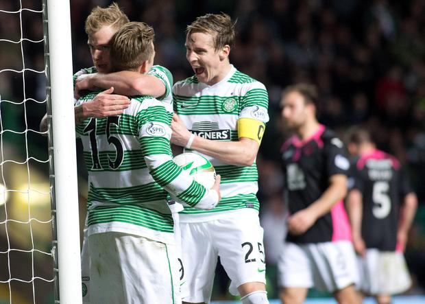 Celtic's Kris Commons (no15) celebrates his goal during the Scottish Premiership match at Celtic Park, Glasgow. PRESS ASSOCIATION Photo. Picture date: Wednesday April 8, 2015. See PA story SOCCER Celtic. Photo credit should read: Kirk O'Rourke/PA Wire. EDITORIAL USE ONLY