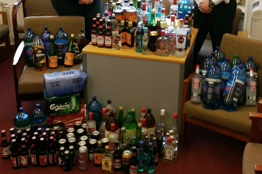 Constables Burns and Coyle are pictured with drink seized from under 18s in the Ports on Easter Monday. PIC: PSNI