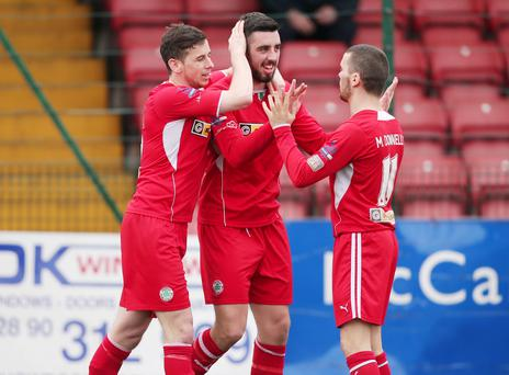 4 April 2015 - Picture by Darren Kidd / Press Eye. Dance Bank Premiership, Cliftonville v Portadown at Solitude. Cliftonville's Joe Gormley celebrates with Eamonn Seydak and Martin Donnelly