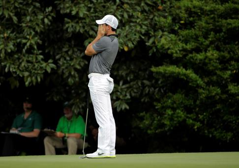 Rory McIlroy, of Northern Ireland, reacts to a missed birdie putt on the 11th hole during the second round of the Masters golf tournament Friday, April 10, 2015, in Augusta, Ga. (AP Photo/David J. Phillip)