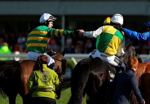 Tony McCoy on Shutthefrontdoor congratulates Leighton Aspell on Many Clouds the winner of the 2015 Crabbie's Grand National at Aintree Racecourse. (Photo by Alex Livesey/Getty Images)