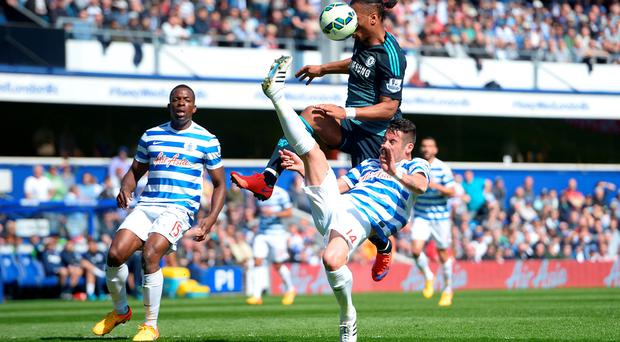 Chelsea's Didier Drogba and Queens Park Rangers' Mauricio Isla battle for the ball during the Barclays Premier League match at Loftus Road, London. Adam Davy/PA Wire.