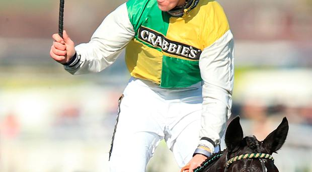 Jockey Leighton Aspell celebrates on board Many Clouds after victory in the Grand National