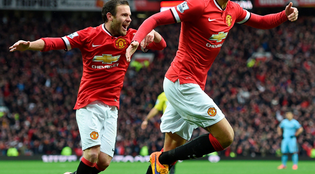 Take that: Chris Smalling enjoys the moment after scoring Manchester United's fourth goal