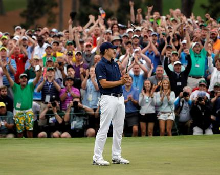 Jordan Spieth celebrates after winning the Masters