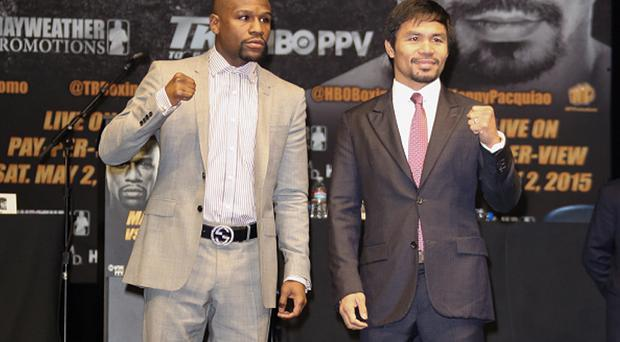LOS ANGELES, CA - MARCH 11: Profesional Boxers Floyd Mayweather and Manny Pacquiao attend the press conference to announce upcoming fight with Floyd Mayweather and Manny Pacquiao at The Nokia Theatre L.A. Live on March 11, 2015 in Los Angeles, California. (Photo by Paul Archuleta/FilmMagic)