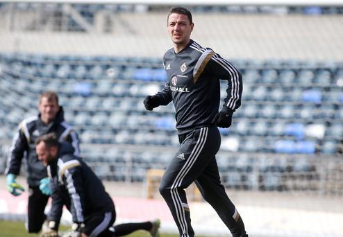 Press Eye - Belfast - Northern Ireland - 28th March 2015 Picture by Jonathan Porter / Press Eye Northern Ireland train at Windsor Park in Belfast ahead of their UEFA Euro 2016 qualifier against Finland on Sunday. The team train on the pitch in front of building work for the new stadium. Chris Baird.