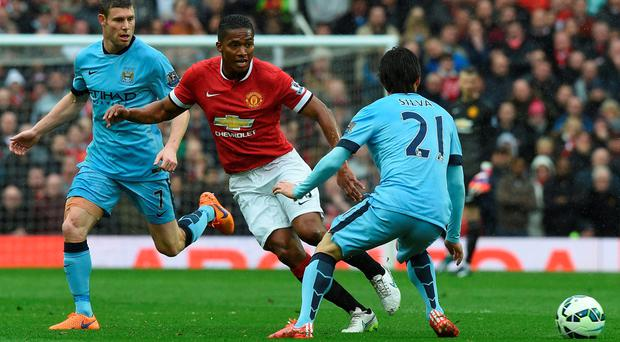 Manchester United's midfielder Antonio Valencia (2nd L) vies with Manchester City's English midfielder James Milner and Manchester City's Spanish midfielder David Silva (R) the English Premier League football match between Manchester United and Manchester City at Old Trafford in Manchester on April 12, 2015.