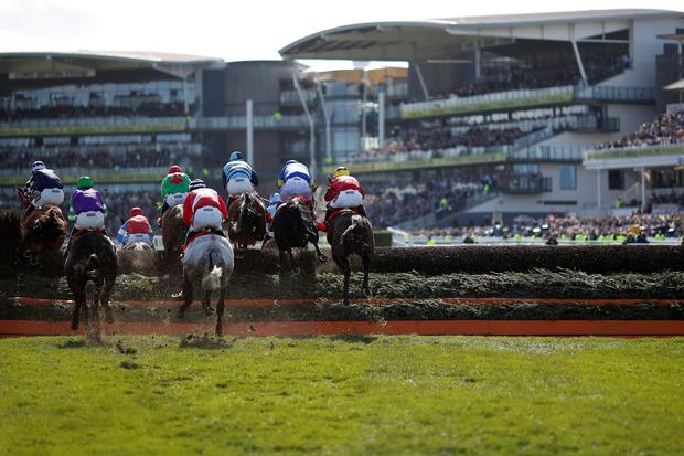 LIVERPOOL, ENGLAND - APRIL 11: A general view as runners clear a fence on Crabbie's Grand National day at Aintree racecourse on April 11, 2015 in Liverpool, England. (Photo by Alan Crowhurst/Getty Images)