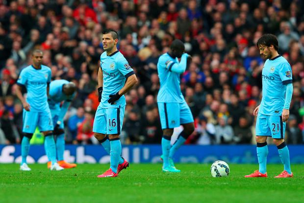 MANCHESTER, ENGLAND - APRIL 12: Sergio Aguero (16) and David Silva of Manchester City (21) look dejected alongside team mates during the Barclays Premier League match between Manchester United and Manchester City at Old Trafford on April 12, 2015 in Manchester, England. (Photo by Alex Livesey/Getty Images)