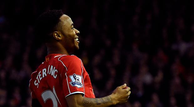 Liverpool's Raheem Sterling celebrates scoring the opening goal of the in Liverpool;s win over Newcastle United at Anfield