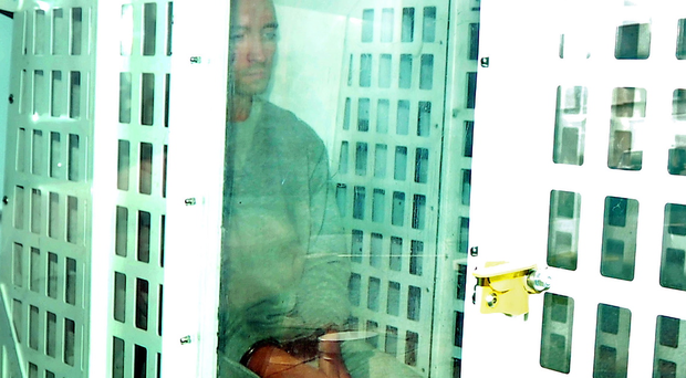 26-year-old Wesley Vance arriving handcuffed in a police prison van at Newtownards Courthouse. He is charged with murdering north Belfast man Kyle Neil