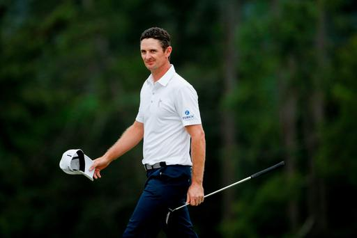 AUGUSTA, GA - APRIL 12: Justin Rose of England on the 18th green during the final round of the 2015 Masters Tournament at Augusta National Golf Club on April 12, 2015 in Augusta, Georgia. (Photo by Ezra Shaw/Getty Images)