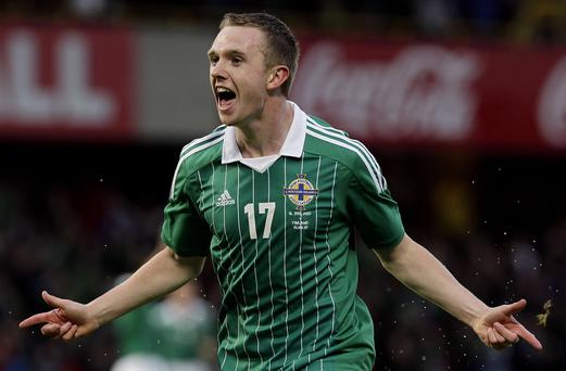 All smiles: Shane Ferguson celebrates his first goal for Northern Ireland in a 3-3 draw against Finland in 2012 but he has yet to play for Rangers since a loan deal from Newcastle in January
