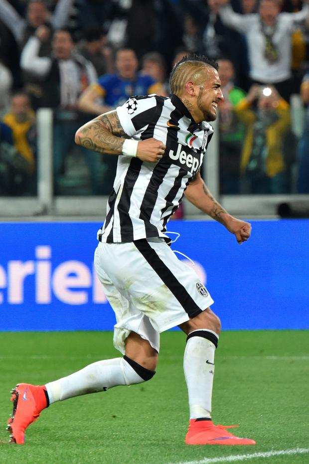Spot on: Arturo Vidal scores a penalty for Juventus