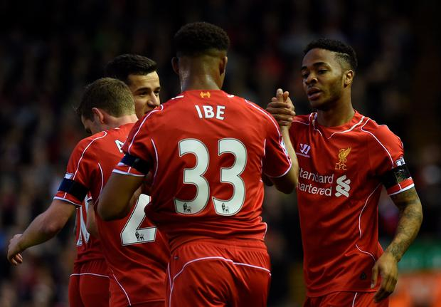 Liverpool's midfielder Raheem Sterling celebrates with Liverpool's midfielder Jordon Ibe