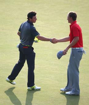 Closing the gap: Jordan Spieth (right) says he's after Rory McIlroy's number one status
