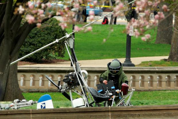 A member of the U.S. Capitol Police Bomb Squad works to check and secure a gyrocopter that landed on the West Front of the U.S. Capitol April 15, 2015 in Washington, DC (Photo by Chip Somodevilla/Getty Images)