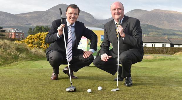 James Finnigan, Commercial Director of the Irish Open and Jason Hempton, Commercial Director - Branded Products, Dale Farm - celebrate Dale Farm's sponsorship of The Dubai Duty Free Irish Open, hosted by the Rory Foundation.