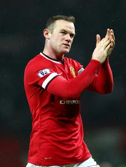 On the move: Wayne Rooney may be played in midfield
