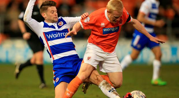 Tackling the Cup: Oliver Norwood (left) fancies an upset for Reading against Arsenal at Wembley