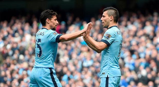 Manchester Citys Jesus Navas and Sergio Aguero (right) celebrate West Ham United's James Collins scoring an own goal the Barclays Premier League match at the Etihad Stadium, Manchester. Martin Rickett/PA Wire.