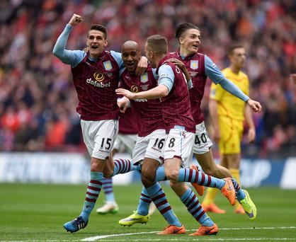 Aston Villa's Fabian Delph (centre) celebrates scoring his side's second goal of the game with team-mates Aston Villa's Ashley Westwood (left), Aston Villa's Tom Cleverley and Aston Villa's Jack Grealish (right) during the FA Cup Semi Final match at Wembley Stadium, London. Andrew Matthews/PA Wire.