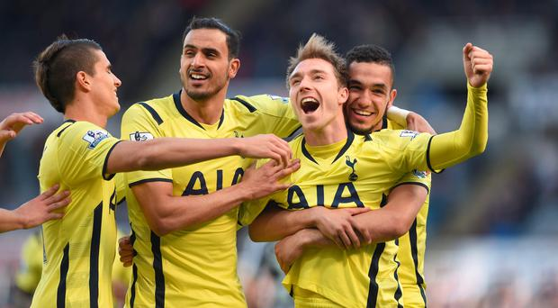 Tottenham Hotspur's Christian Eriksen (centre) celebrates scoring their second goal of the game with team-mates Erik Lamela (left) Nacer Chadli and Nabil Bentaleb (right) during the Barclays Premier League match at St James' Park, Newcastle. Owen Humphreys/PA Wire.