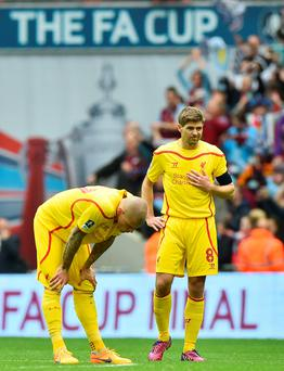 It's a knockout: Steven Gerrard and Martin Skrtel show their frustration
