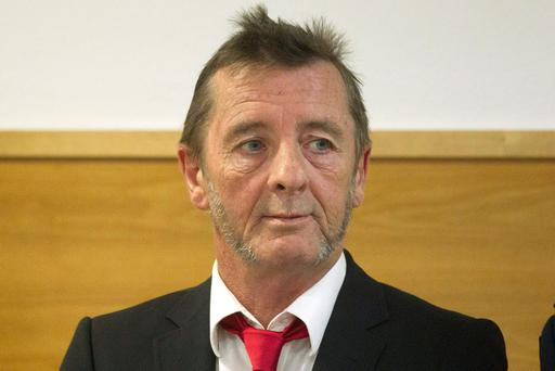 AC/DC drummer Phil Rudd stands in the dock at a court in Tauranga, New Zealand, Tuesday, April 21, 2015. Rudd pleaded guilty to a charge of threatening to kill a man who used to work for him. He also pleaded guilty to possessing methamphetamine and marijuana. (Christine Cornege/New Zealand Herald via AP)
