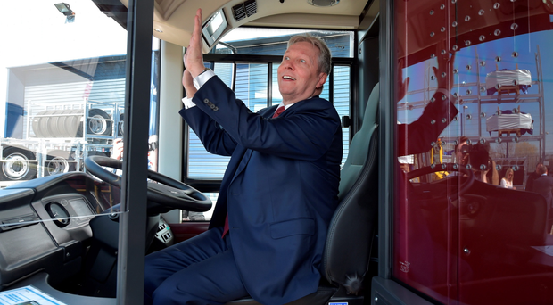 Peter Robinson sits behind the wheel of a London Routemaster bus at the launch of the Democratic Unionist Party election manifesto at Wrightbus in Antrim. Pic Charles McQuillan/Getty