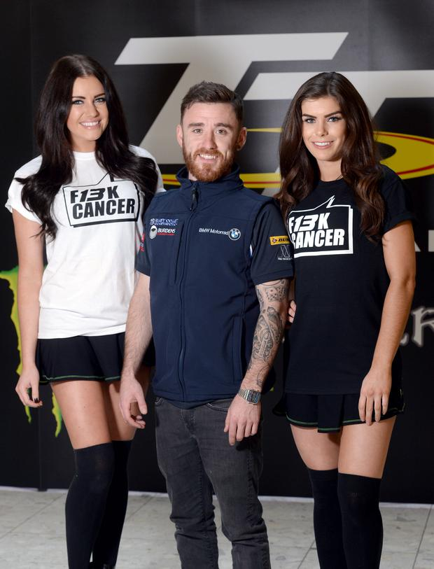 Lee Johnston with models sporting his charity's T-shirts