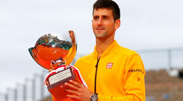 Novak Djokovic of Serbia celebrates with the winners trophy after defeating Tomas Berdych of Czech Republic in the final during day eight of the Monte Carlo Rolex Masters tennis at the Monte-Carlo Sporting Club on April 19, 2015 in Monte-Carlo, Monaco.
