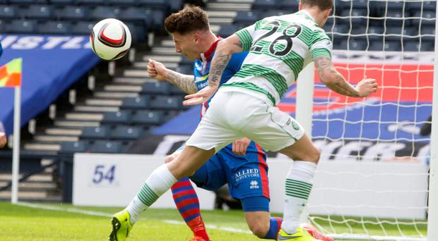 Helping hand: Josh Meekings uses his arm to block Leigh Griffiths' header at Hampden Park