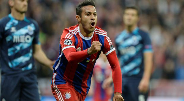 Bayern Munich's Spanish midfielder Thiago Alcantara celebrates scoring the 1-0 goal during the UEFA Champions League second-leg quarter-final football match Bayern Munich v FC Porto in Munich.