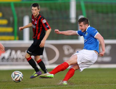 Pick it out: Linfield's Michael Carvill fires home against champions Crusaders at the Oval