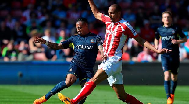 Nathaniel Clyne of Southampton challenges Steven Nzonzi of Stoke