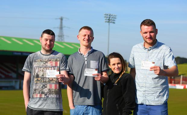 Matthew Montgomery, Ryan Bell, Sarah McCann and Nathan Bell who bough the last available tickets for the gamePicture - Kevin Scott / Belfast Telegraph