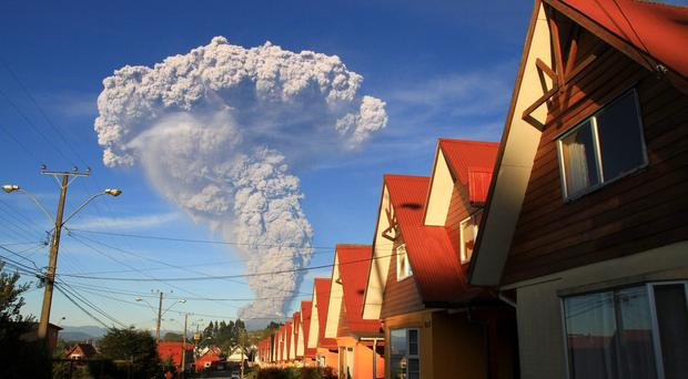The Calbuco volcano is seen erupting from Puerto Varas, Chile, Wednesday, April 22, 2015. The volcano erupted billowing a huge ash cloud over a sparsely populated, mountainous area in southern Chile.