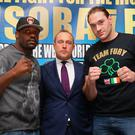 Francis Warren stands between Dereck Chisora and Tyson Fury (Photo by Alex Livesey/Getty Images)