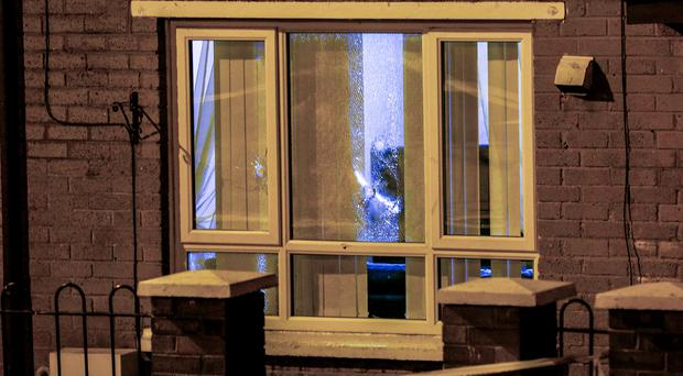 Pictured is police at the scene of a shooting in the Norglen Drive area as a number of shots were fired through the window of a property at around 1:45 am Picture - Kevin Scott / Presseye News