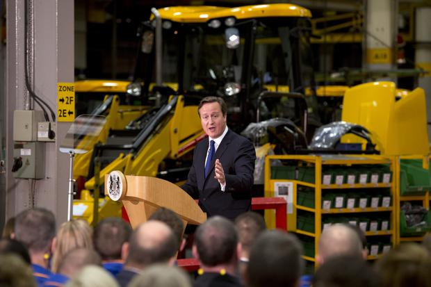 Cash for adverts? Major Tory donor benefits from Government's advertising spending spree. Above: David Cameron delivers a speech on immigration to members of the media at JCB World Headquarters on November 28, 2014 in Rocester, United Kingdom. (Photo by Oli Scarff - WPA Pool/Getty Images)