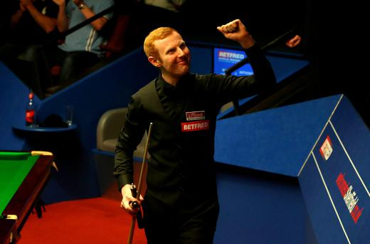 Anthony McGill celebrates beating Mark Selby