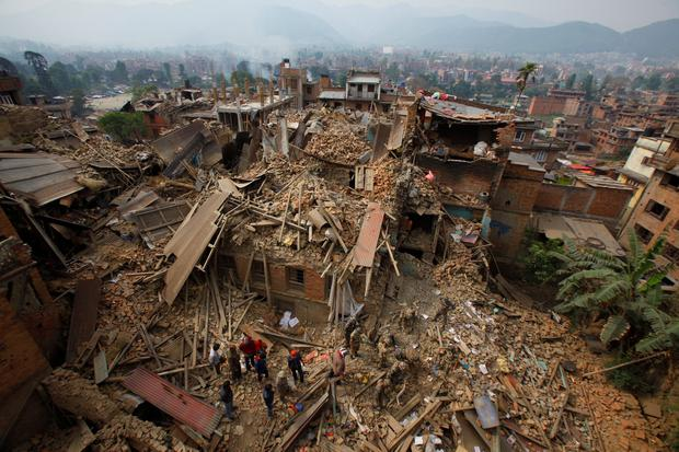 Rescue workers remove debris as they search for victims of earthquake in Bhaktapur near Kathmandu, Nepal, Sunday, April 26, 2015. (AP Photo/Niranjan Shrestha)