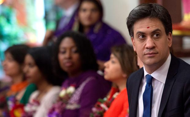 Labour leader Ed Miliband and his wife Justine meet Hindu devotees at the Shree Swaminarayan Temple in Willesden Green, London, where they attended a celebration ceremony. Stefan Rousseau/PA Wire