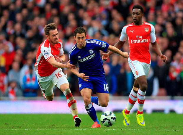 Chelsea's Eden Hazard (centre) in action with Arsenal's Aaron Ramsey (left) and Danny Welbeck during the Barclays Premier League match at the Emirates Stadium, London. Nick Potts/PA Wire.
