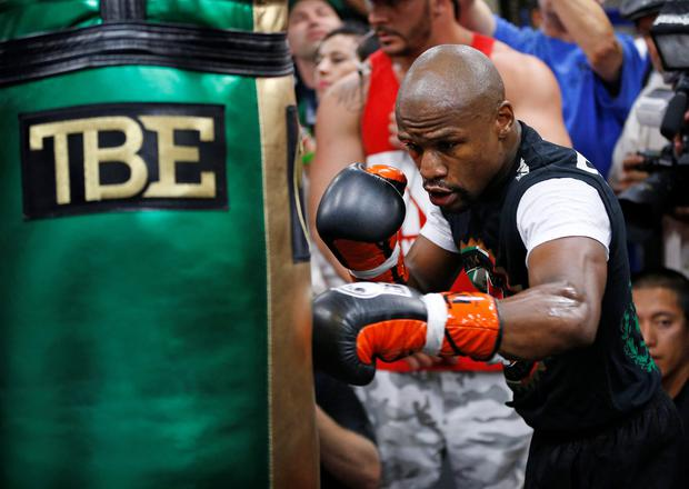 Floyd Mayweather Jr. hits a heavy bag Tuesday, April 14, 2015, in Las Vegas. Mayweather is scheduled to face Manny Pacquiao in a welterweight boxing match in Las Vegas on May 2. (AP Photo/John Locher)